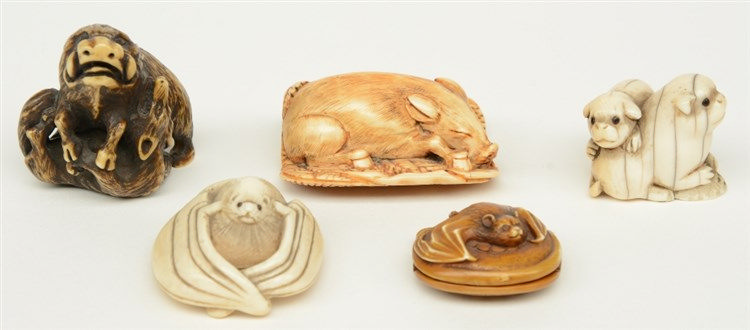 Four late Edo period Japanese ivory katabori-netsuke, in the form of a boar