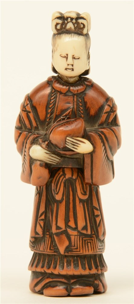 A Japanese early Meiji period  erotic boxwood and bone netsuke depicting a