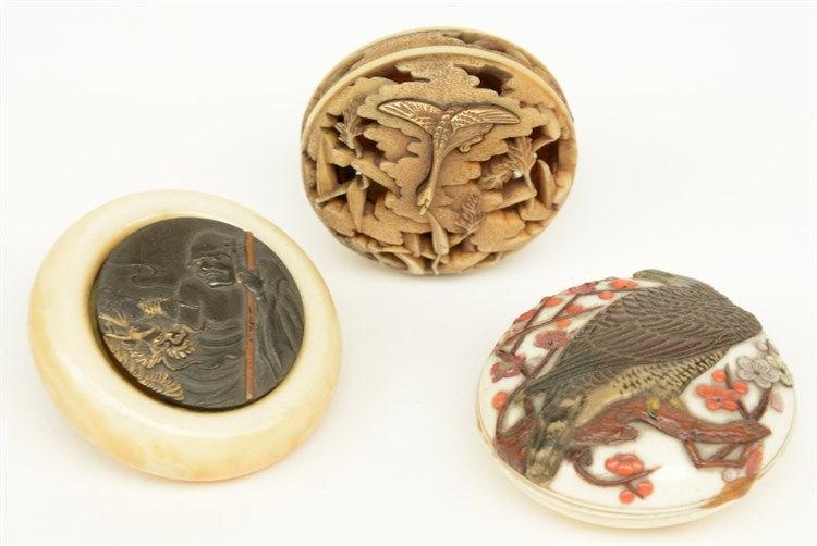 Three late Edo and early Meiji period Japanese ivory Manju-netsuke, one of