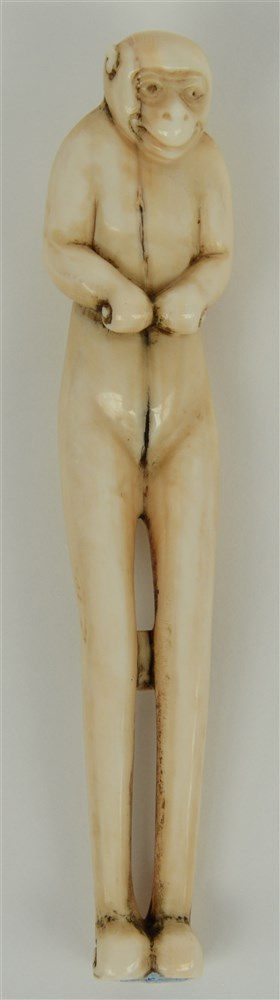 A late Edo period Japanese ivory shashi-netsuke, in the form of a monkey, H