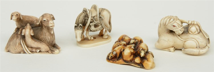 Four late Edo period Japanese ivory katabori-netsuke, two in the form of ho