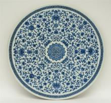 A large Chinese blue and white floral tile, Diameter 51,5 cm