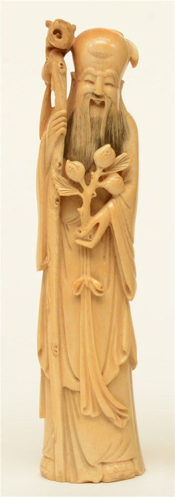 A Chinese ivory sculpture depicting Shou Xing, marked, late 19thC, H 26,5 c