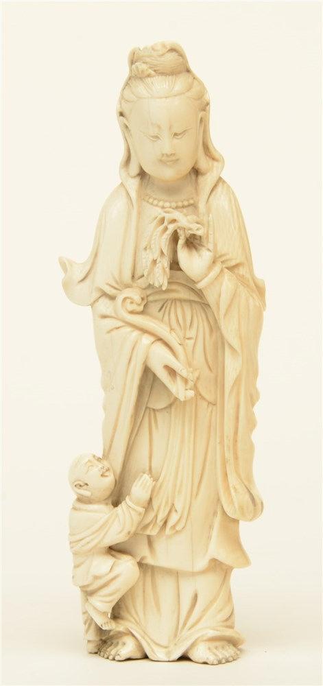 A Chinese ivory Guanyin accompanied by a child, Canton, third quarter of th