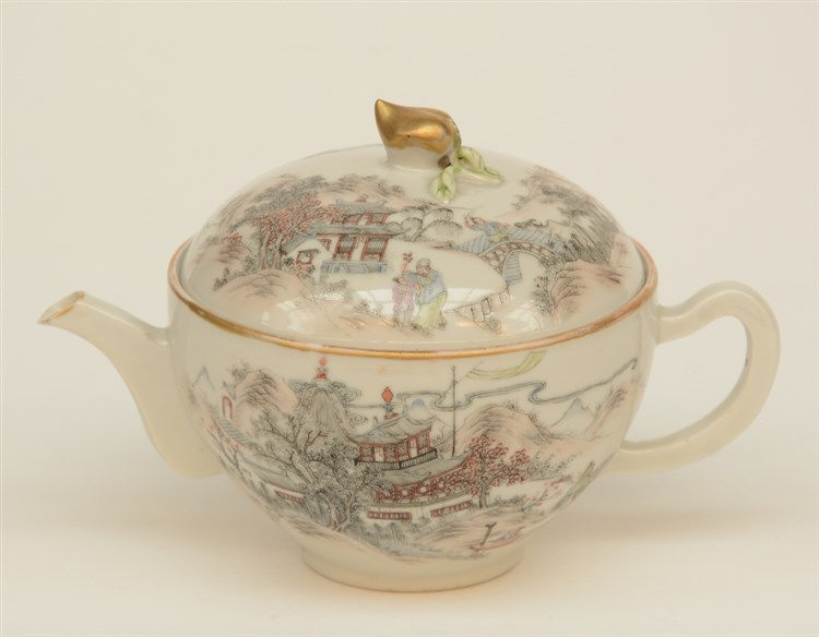 A Chinese polychrome decorated teapot, painted with figures in a landscape,