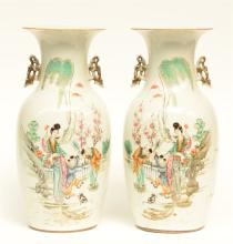 A pair of Chinese polychrome vases, decorated with children playing in a ga