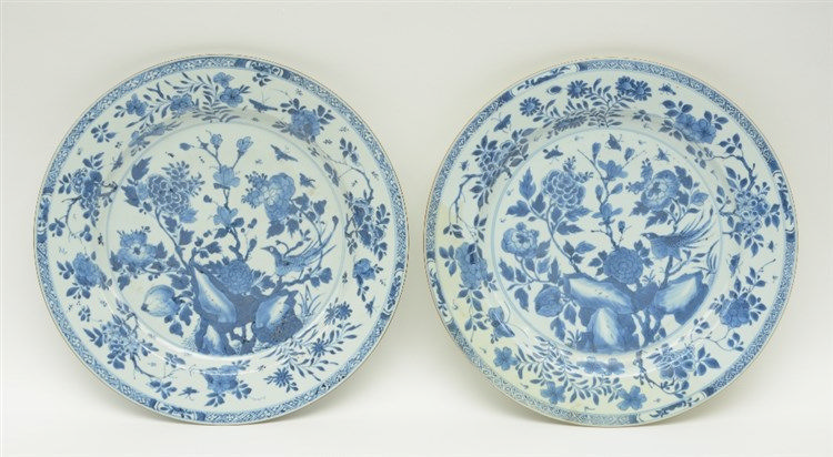 Two Chinese blue and white plates decorated with a bird and flower branches