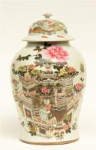 A Chinese famille rose vase and cover, decorated with vases of flowers and