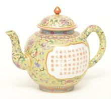 A Chinese green ground and famille rose teapot, marked Jiajing, 19thC, H 15