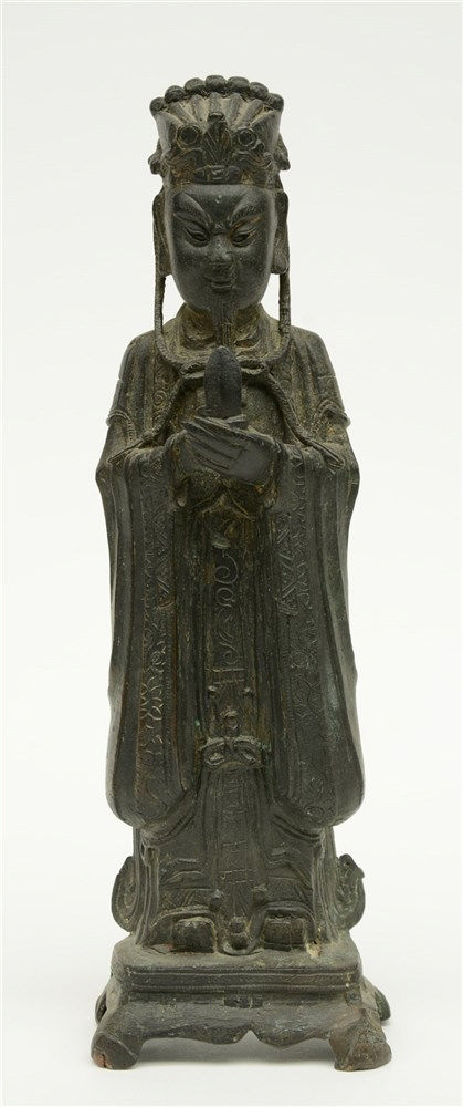 A Chinese bronze figure depicting a dignitary, probably Ming, H 33,5 cm (mi