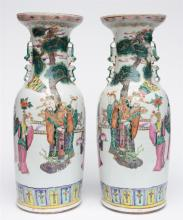 An exceptional pair of Chinese famille rose vases, overall decorated with I