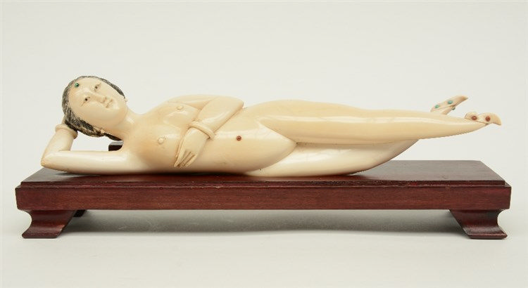 A fine Chinese ivory 'medicine lady' on a wooden base, scrimshaw decorated,