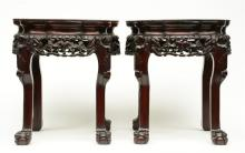 A pair of Chinese carved wooden stools with marble top, H 46 - W 41 - D 41