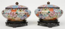 Two Chinese cloisonné pots with cover, decorated with floral motifs, on mat