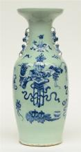 A Chinese celadon ground blue and white vase, decorated with vases of flowe