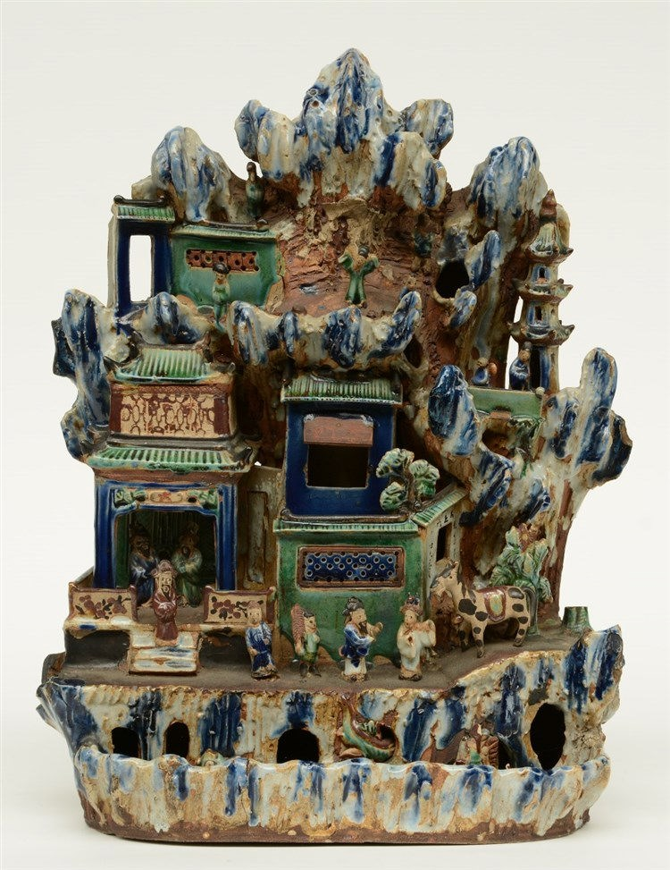 A Chinese doucai earthenware sculpture, depicting the Eight Immortals in th