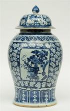 An impressive Chinese blue and white decorated vase and cover, painted with