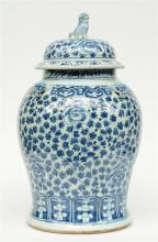 An imposing Chinese blue and white decorated vase and cover, relief moulded
