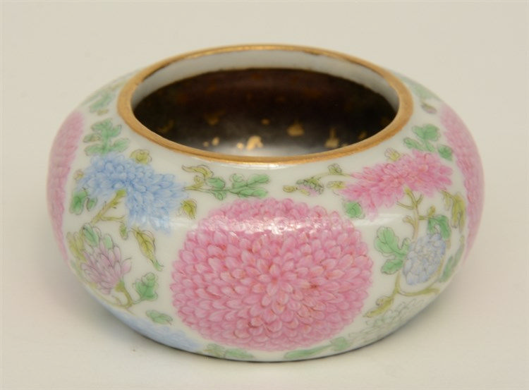 A Chinese famille rose waterpot, decorated with flowers, marked Yongzheng,