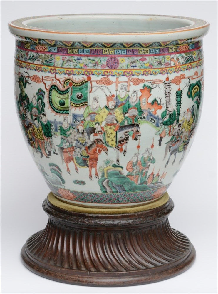 A Chinese famille verte fish bowl, decorated with a court scene, on a woode