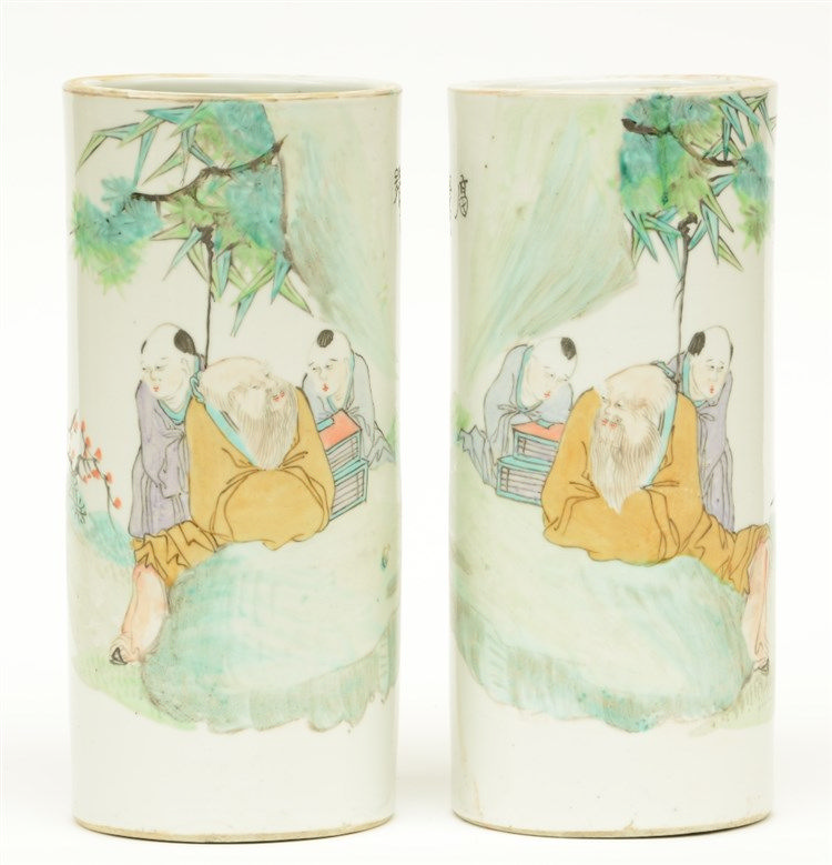 A pair of Chinese cylinder shaped polychrome vases, decorated with an anima