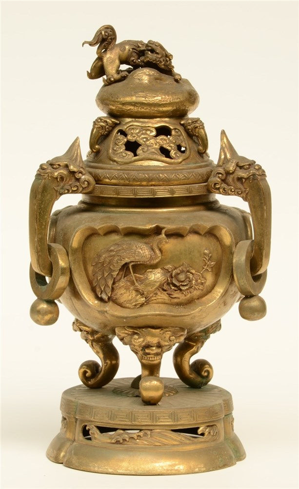 A Chinese gilt bronze incense burner, relief decorated, H 36 cm