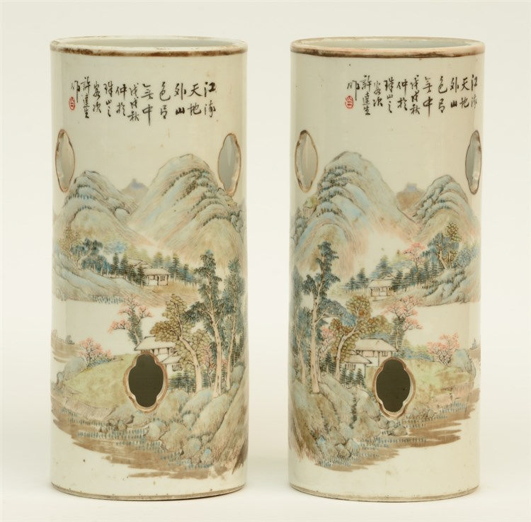 A pair of Chinese hat stands, polychrome decorated with a landscape, marked