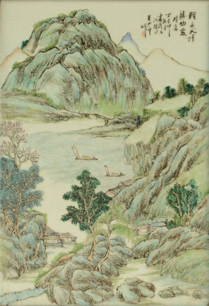 A Chinese polychrome plaque decorated with a mountanious river landscape, i