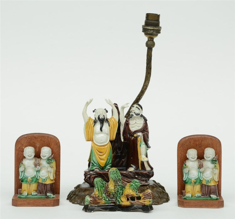 A pair of Chinese sancai mud-men and a brush holder, 19thC; added a ditto g