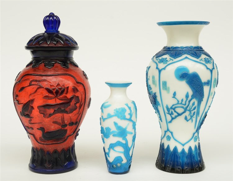 Two Chinese vases and a vase and cover, in colored and laminated glass, dec