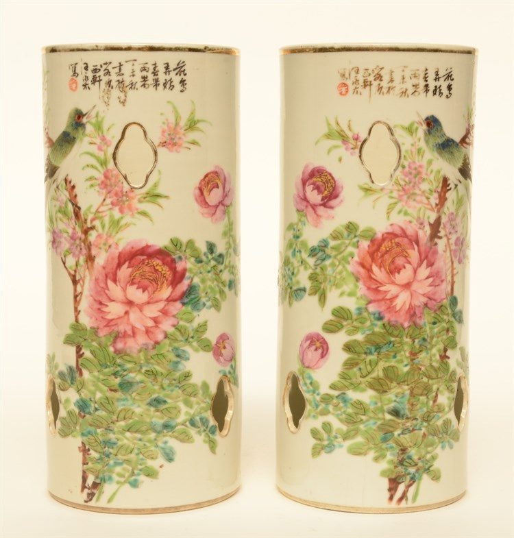A pair of Chinese famille rose hat stands, decorated with a bird on a flowe
