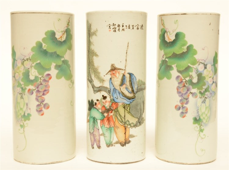 A pair of Chinese polychrome cylinder shaped vases, decorated with grape br