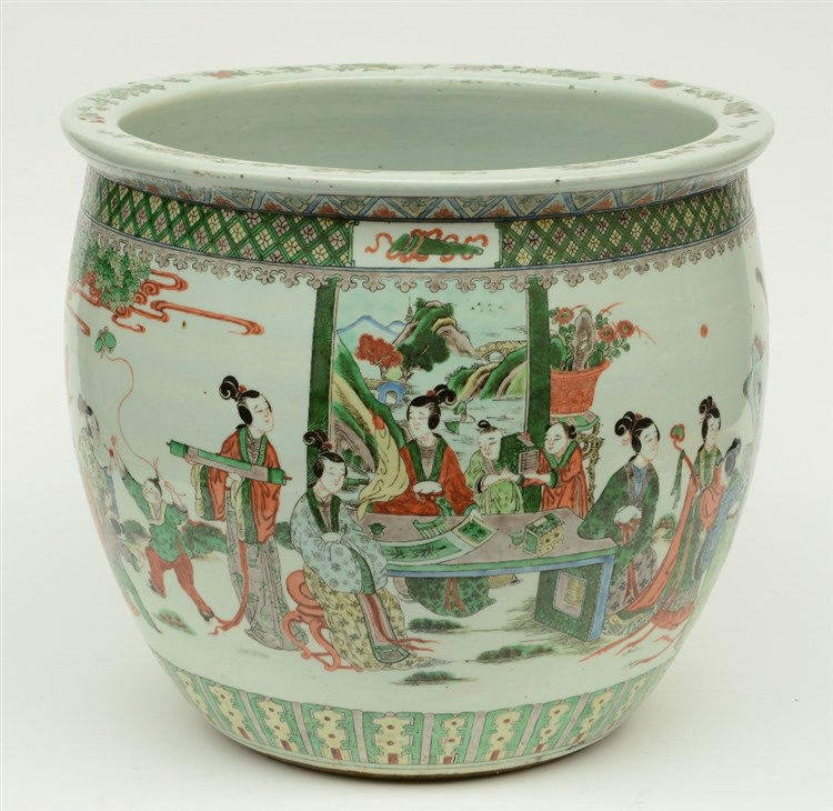 A Chinese famille verte jardinière overall decorated with an animated scene