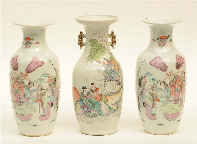 A Chinese pair of vases, polychrome decorated with an animated scene, marke