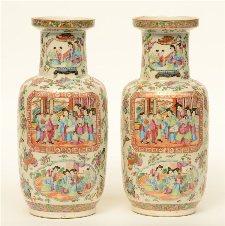 A pair of 19thC Chinese famille rose rouleau vases, the panels painted with