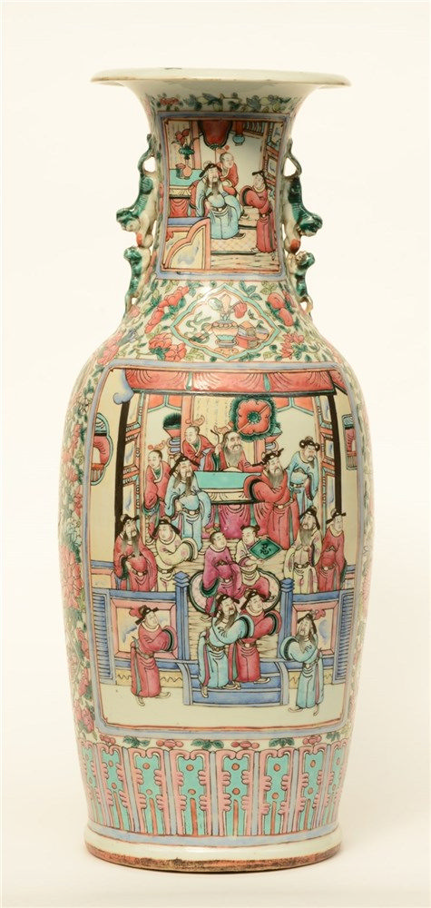 A Chinese famille rose vase, the panels painted with courtscenes, H 60 cm (