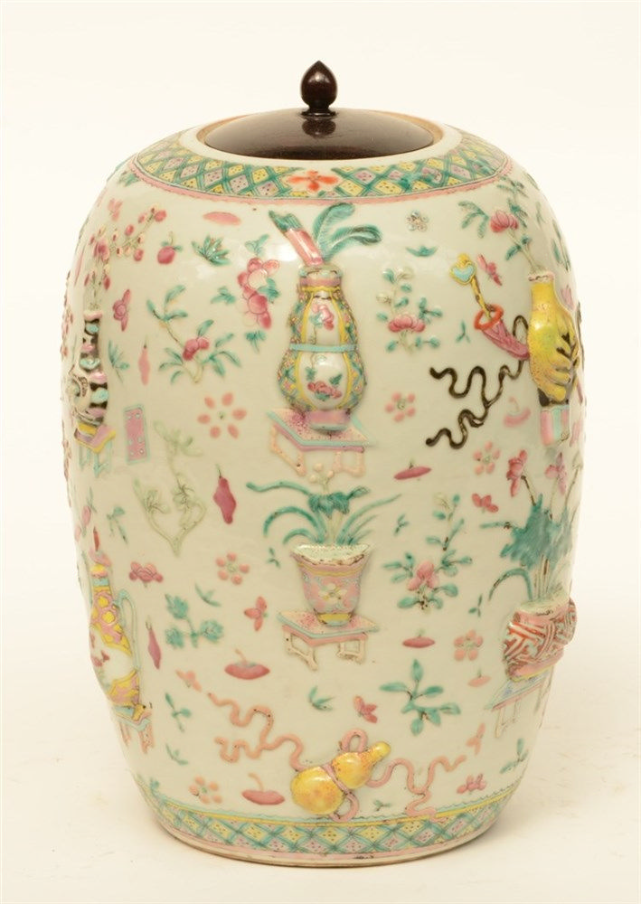 A 19thC Chinese famille rose ginger pot and cover, relief moulded with a va
