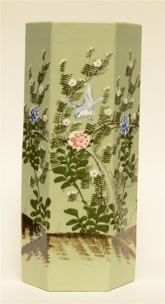 A celadon ground hexagonal Japanese vase, overall polychroom decorated with