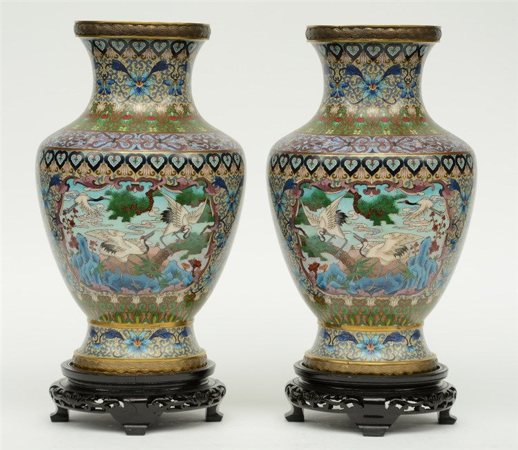 A pair of Chinese cloissoné vases, the panels decorated with cranes, on mat