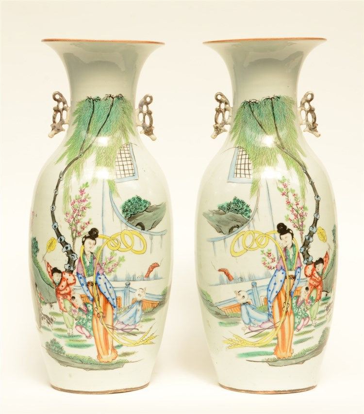 A pair of Chinese polychrome vases, decorated with a lady with children pla