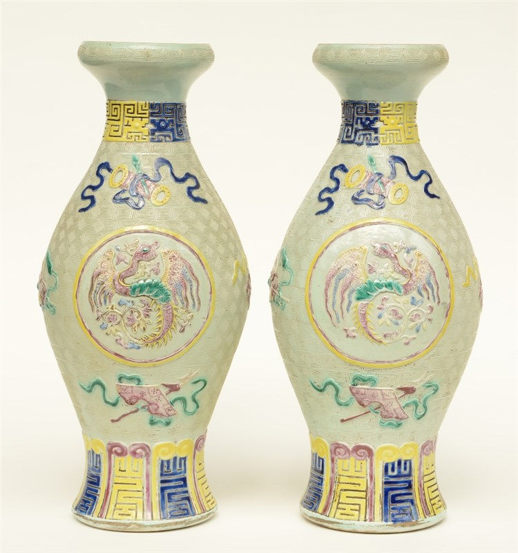 A pair of Chinese celadon ground baluster shaped vases polychrome and relie