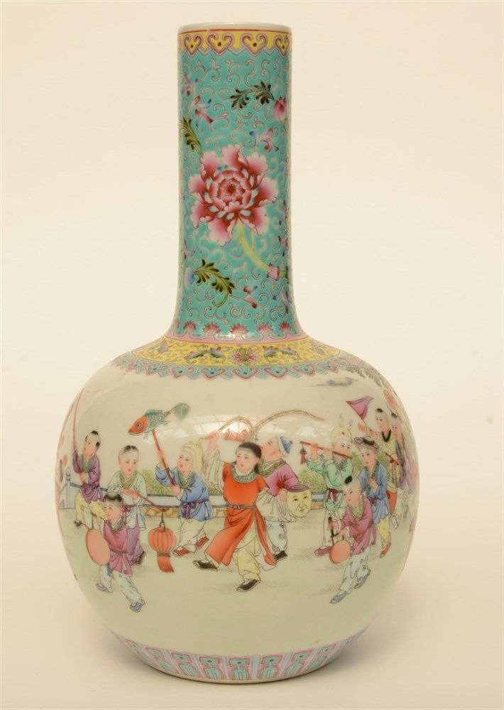 A Chinese famille rose bottle vase decorated with an animated scene with ch