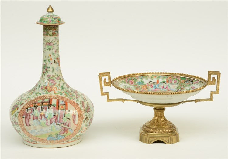 A Chinese Canton bottle vase, famille rose decorated with court scenes, 19t