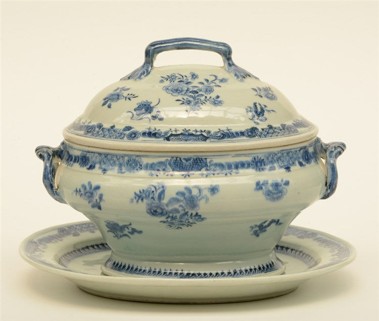 A 19thC blue and white decorated Chinese porcelain tureen on a matching dis
