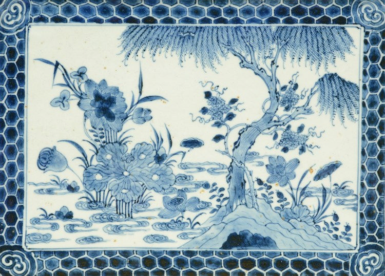 An 18thC blue and white decorated Chinese tile, the central part painted wi