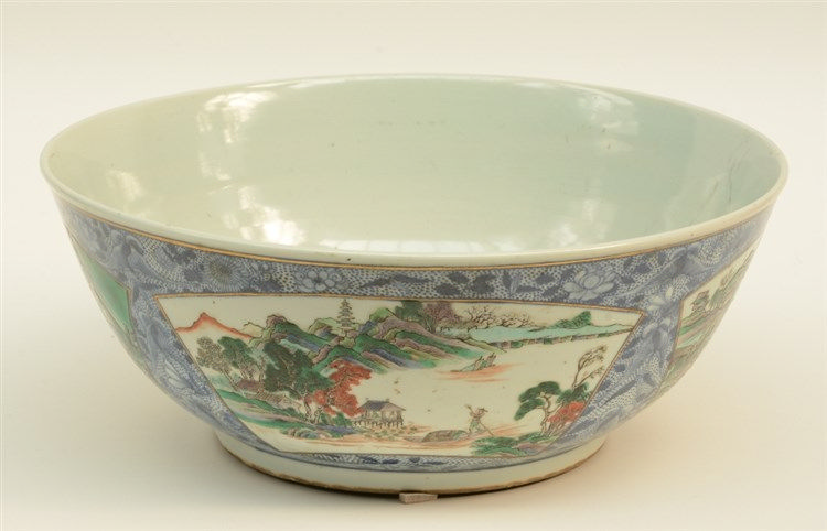 An 18thC Chinese bowl, blue and white decorated ground and with fan shaped