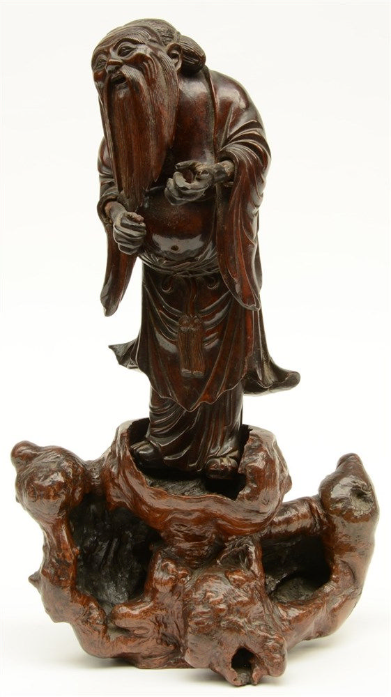 A Chinese hardwood and burl sculpture depicting a Chinese philosopher on a