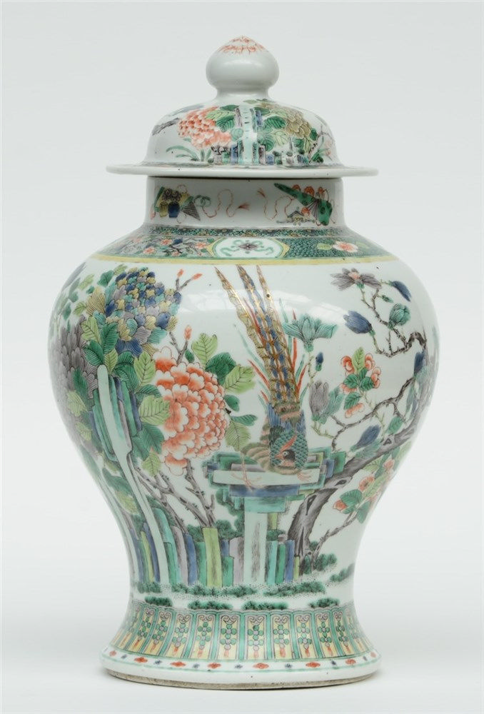 A Chinese famille verte vase and cover, overall decorated with birds on flo