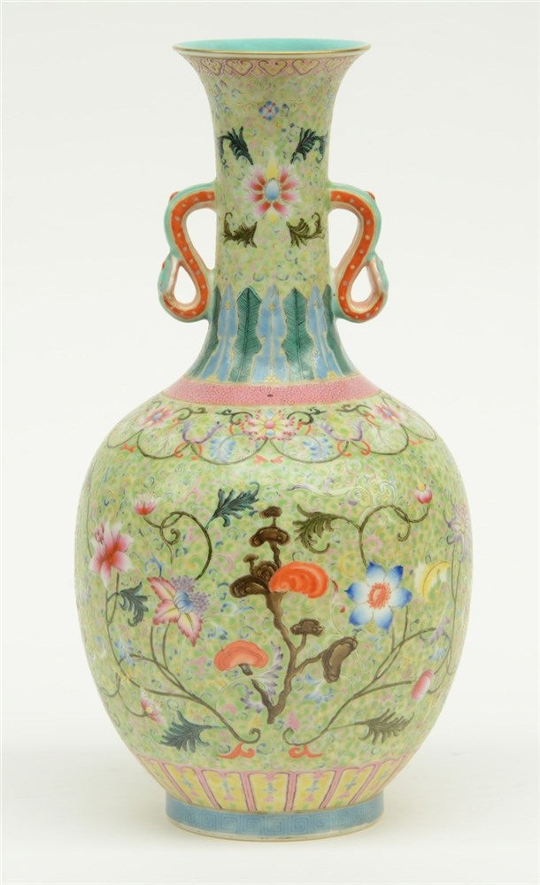A Chinese famille rose, decorated with floral motifs, the handles relief mo