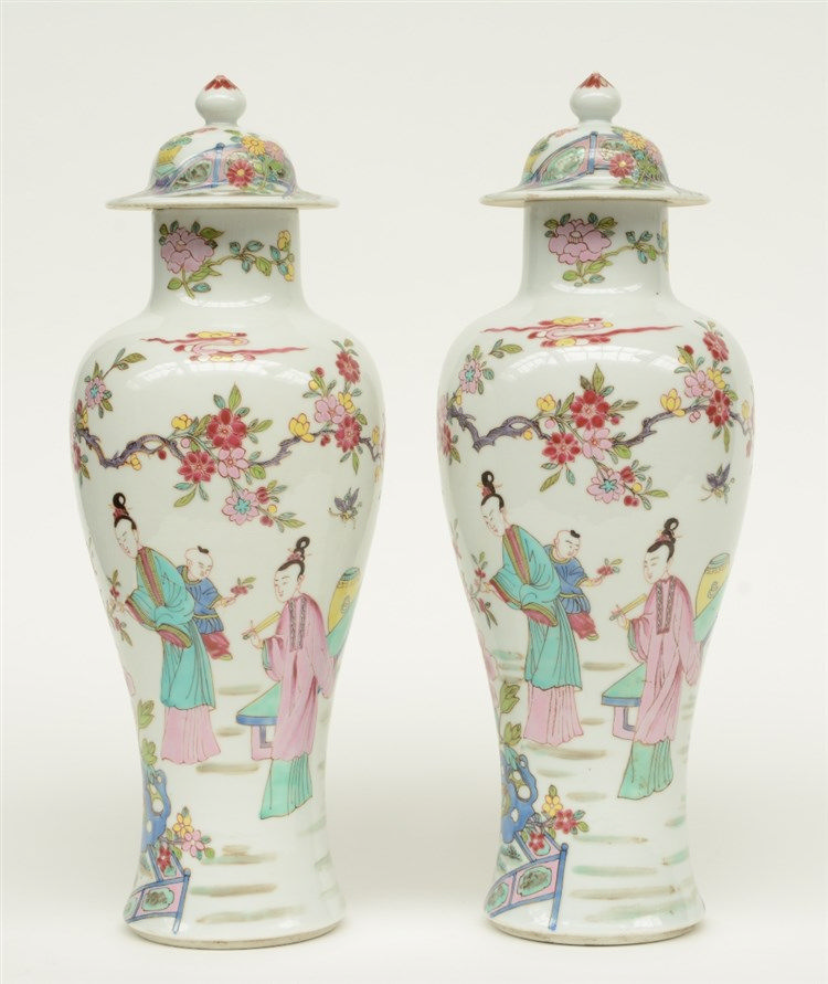 Two Chinese famille rose baluster shaped vases and covers, decorated with f